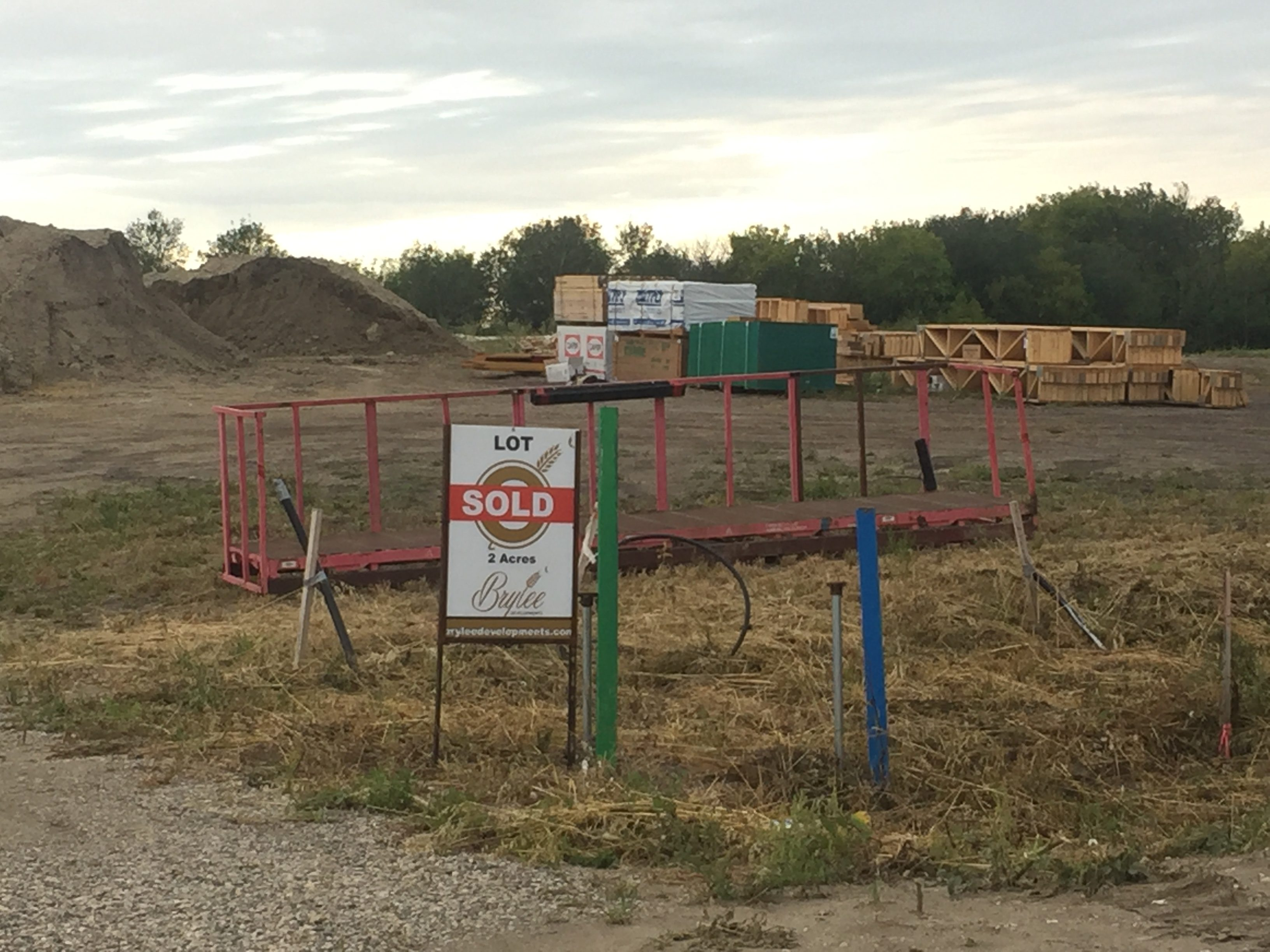 Lots 6 Sold Sign with Construction Odds and Ends